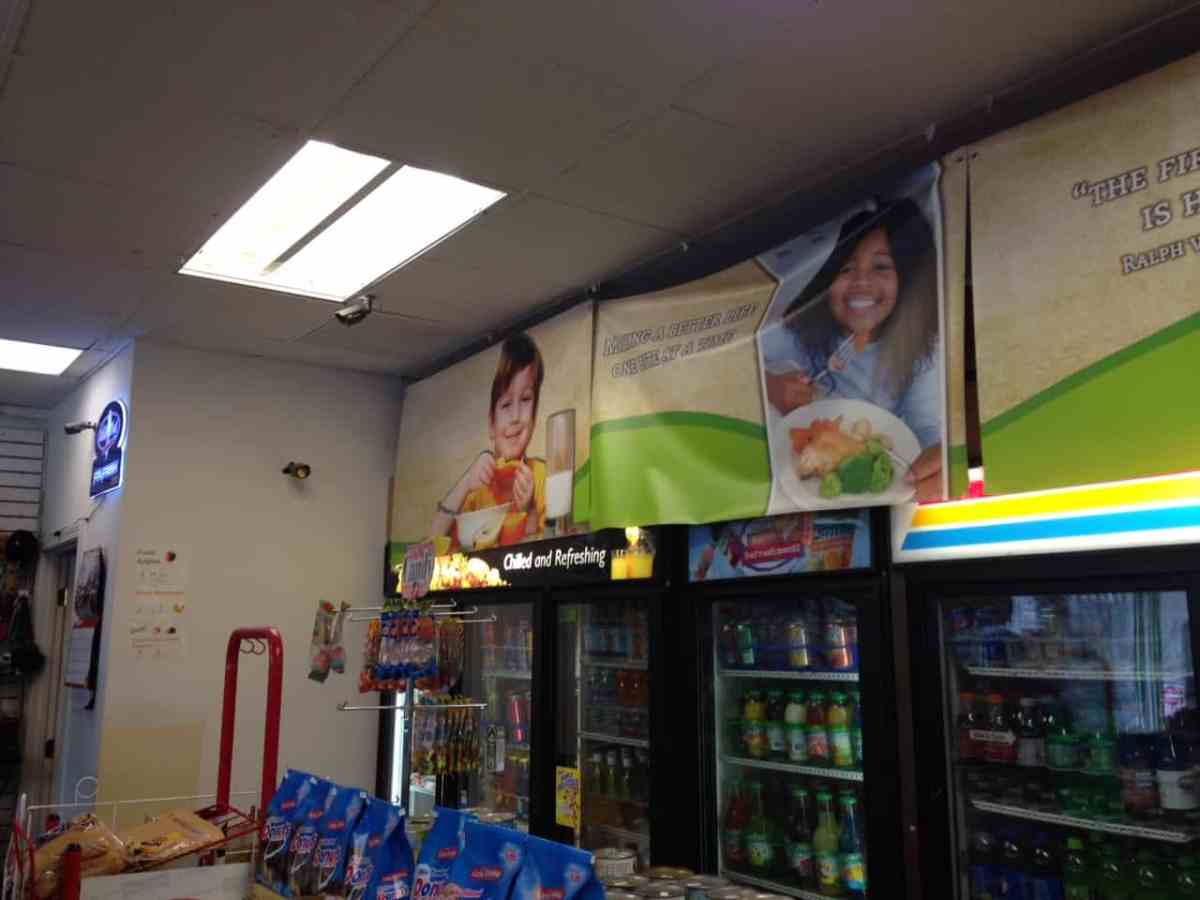 The corner store at North Roxboro and Geer Streets in Old North Durham has decorated with posters and banners promoting healthy food choices for children.