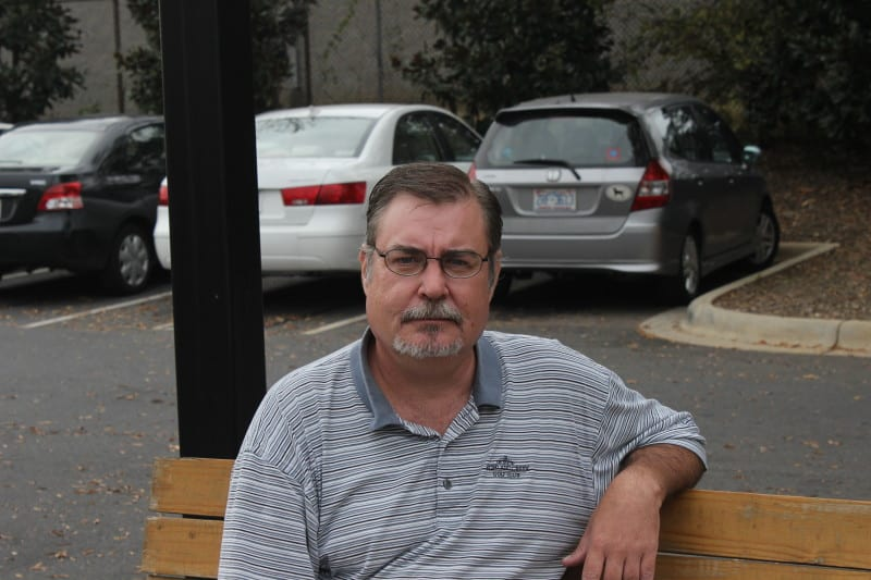 Moore Place resident Justin Markel has been able to use the facility as a place to start over. Photo shows a well-groomed Justin sitting on a park bench.