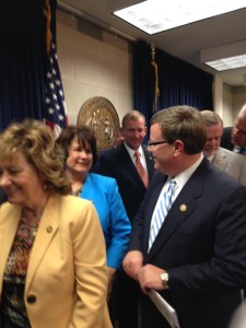 House Speaker Tim Moore (R-Kings Mountain, striped tie) chats with Rep. Pat McElraft (R-Emerald Isle) after a press conference to introduce the state budget. Behind Moore are Senate Majority Leader Harry Brown (R-Jacksonville), left, and Senate President Pro Tempore Phil Berger (R-Eden), right.