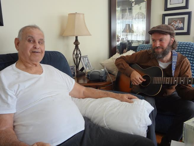 """""""I think it's just heart-opening, is really what it is,"""" said music therapist Jay Brown, seen here with client Bobby Joe Keever. Photo credit: Taylor Sisk"""
