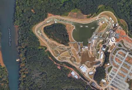 The US Whitewater Center in a Google Earth image. The loops on the right and left are each closed and all the water has been drained from the upper pond as the Center cleans.