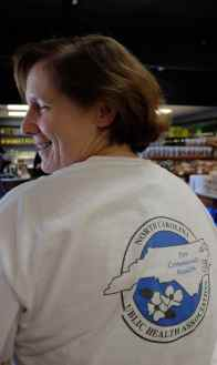 Former State Epidemiologist Megan Davies sports her NC Public Health Association t-shirt on a recent afternoon. Davies says she does not regret resigning in protest over how leaders in the Department of Health and Human Services moved to discredit decisions made by the state toxicologist in conjunction with her office.