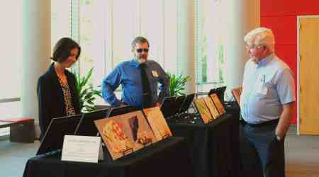 Attendees at the Lives on the Hill event Sunday, held at the Talley Student Union on the NC State University campus. John Myhre (right) was interviewed for a series of videotaped oral histories shown at the event. Photo credit: Karen Tam