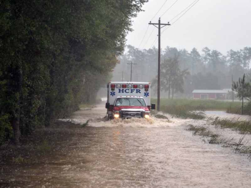Soldiers with the 1-178th Field Artillery Battalion, South Carolina Army National Guard (ACNG) help escort Horry County Fire Rescue paramedics through flooded roads to reach someone in need of medical attention in Conway, S.C., during Hurricane Matthew, Friday, Oct. 8, 2016. SCNG Soldiers and Airmen were activated Oct. 4, 2016 in support of state and county emergency management agencies and local first responders with coastal evacuations and any services or resources needed to assist the citizens of South Carolina after Governor Nikki Haley declared a State of Emergency. U.S. Air National Guard photo by Tech. Sgt. Jorge Intriago.