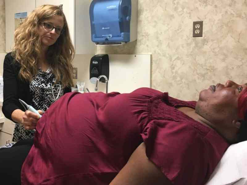 Jennifer Perry-Hidalgo, a certified nurse midwife, treats Claire Ida Jean Charles, who is receiving medication to reduce her chances of giving birth prematurely.