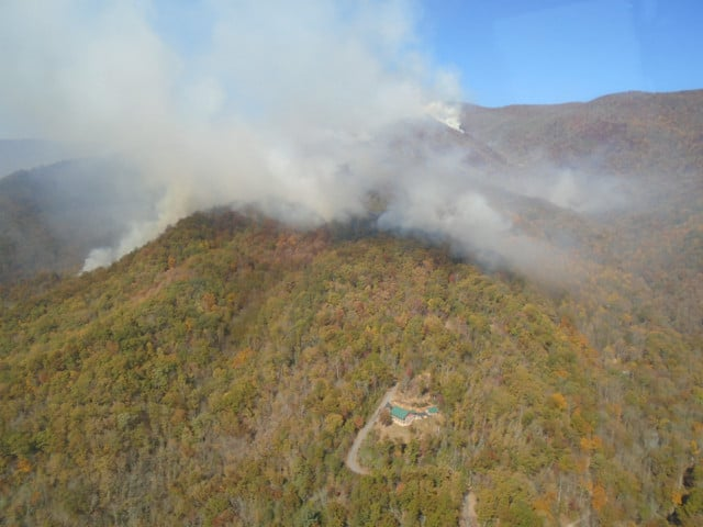 The Boteler Fire backs over a ridge on the southeast flank of the fire. Photo by Mark Jamieson, USFS