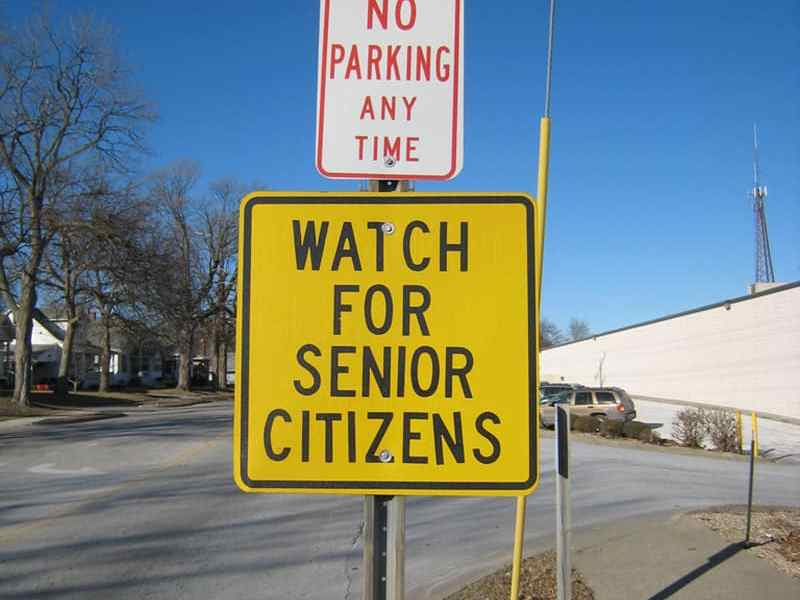 """shows a street sign reading, """"Watch for Senior Citizens"""""""