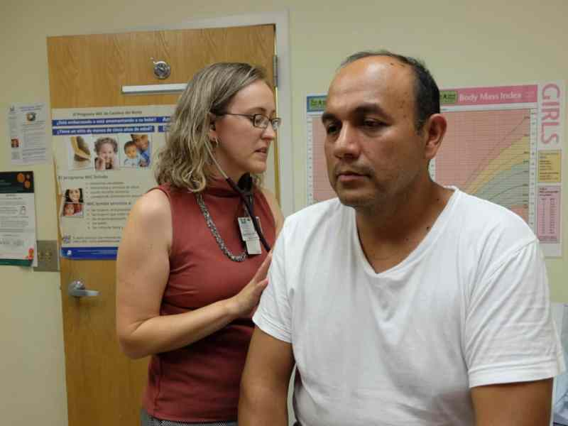 A doctor and patient in a community health center