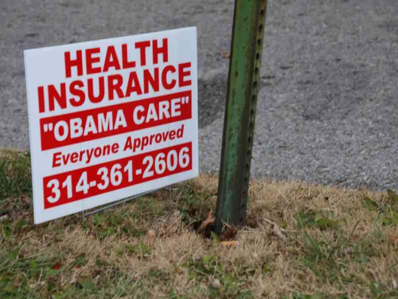 """sign saying health insurance, """"Obamacare"""" Everyone approved"""