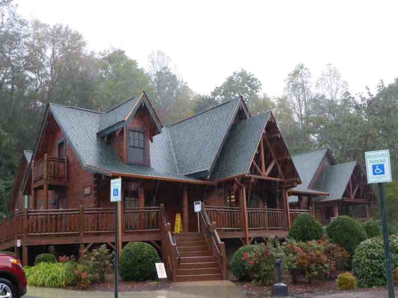 Shows a large log cabin home.