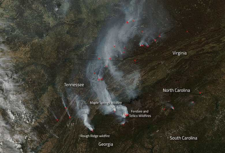 shows satellite image of western NC, with smoke from wildfires being blown east and south