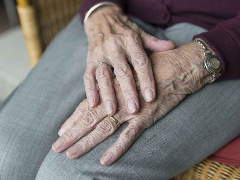 Shows the hands of an elderly woman. Pain medication, opioids