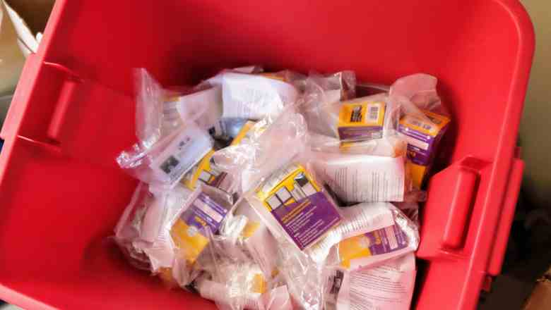 shows a bin with plastic bags filled with naloxone and other supplies