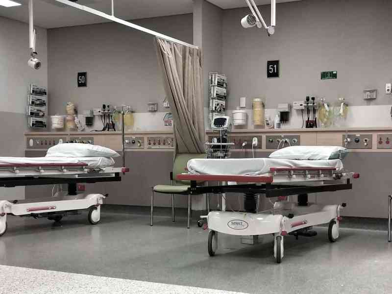 shows an empty emergency room trauma bay, with gurneys and equipment ready for patients to arrive, perhaps at a rural hospital