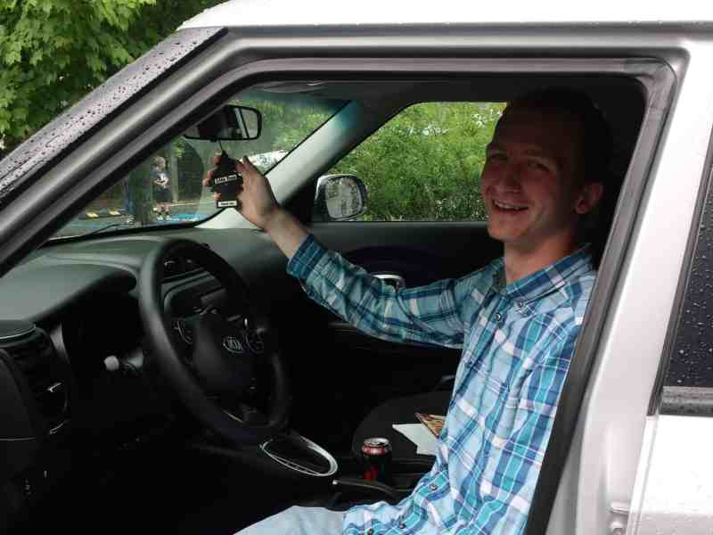 a Crossnore graduate sits behind the wheel of a new car, he holds the air freshener hanging from the rear view mirrow
