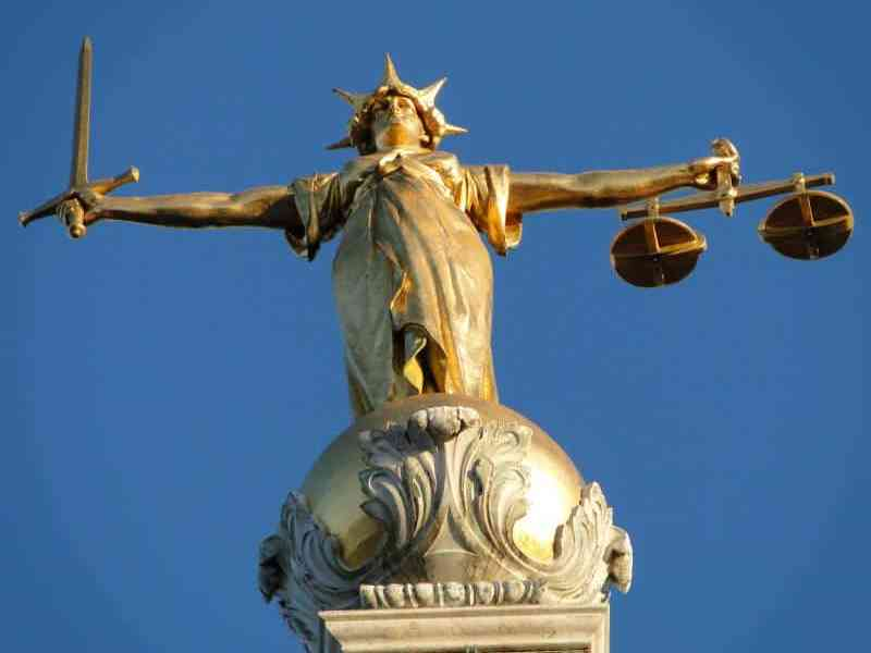 shows image of Lady Justice from the Old Bailey in London, managed care