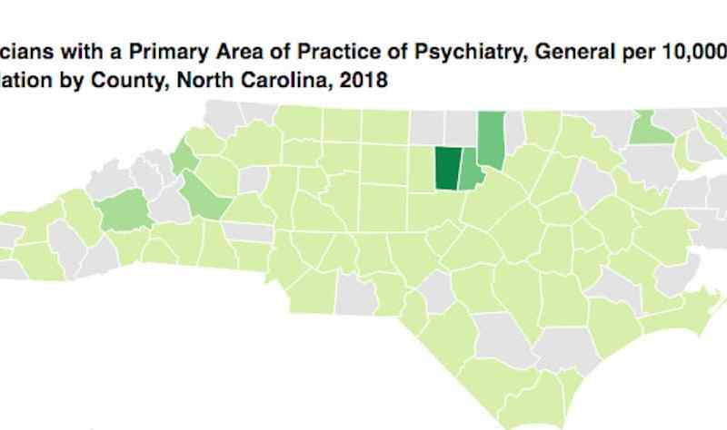 shows map of NC with counties that have psychiatrists noted in green, a handful of counties are grey (no psychiatrist) and a smaller number are colored darker green (more psychiatrists)