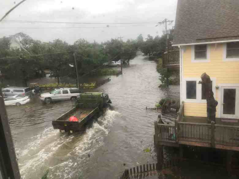 shows a truck driving through high water on Ocracoke