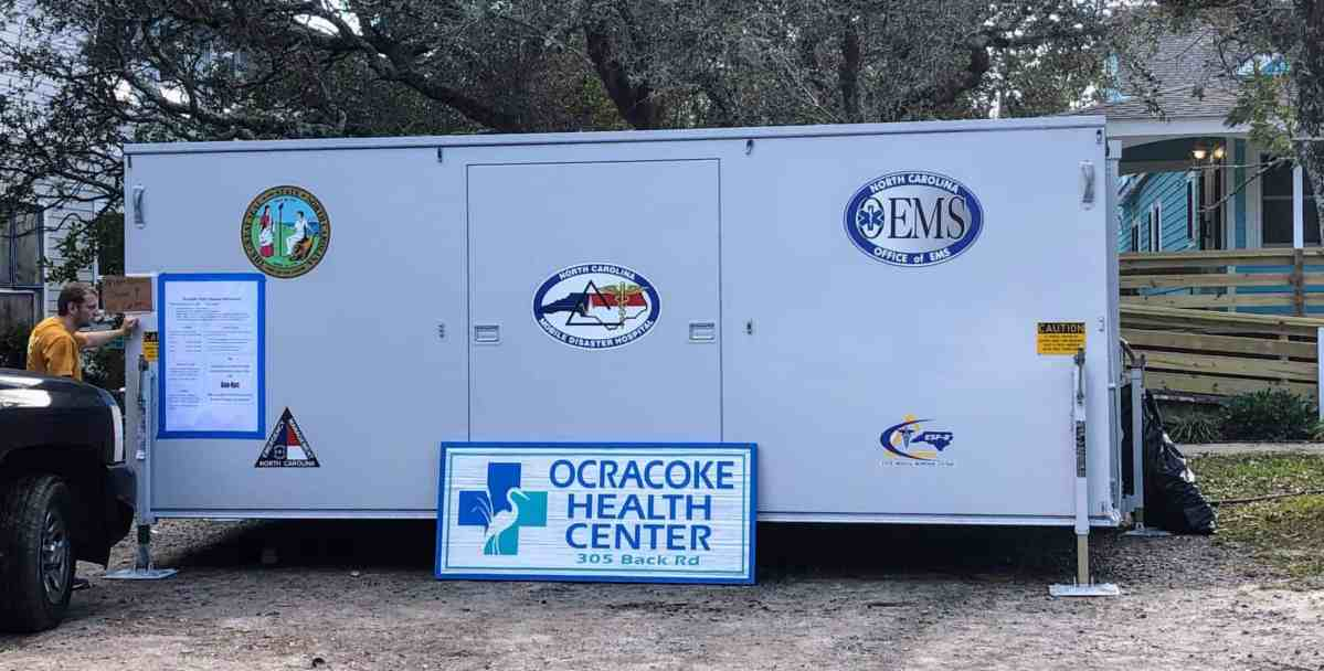 A mobile unit with the Ocracoke Health Center sign in front.