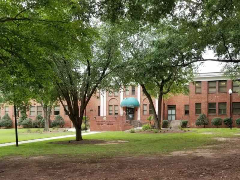 A red brick building that houses NCDHHS. The department found years of foster care errors.