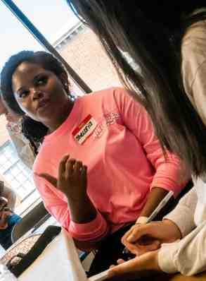 Two young women speak to one another during the Florence resiliency workshop