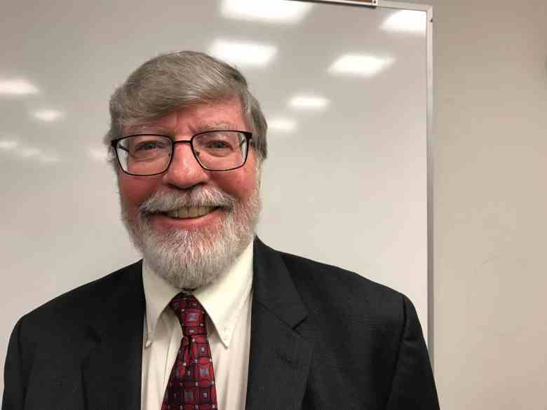 a bearded man smiles at the camera. He says he's looking to see Medicaid expansion in NC