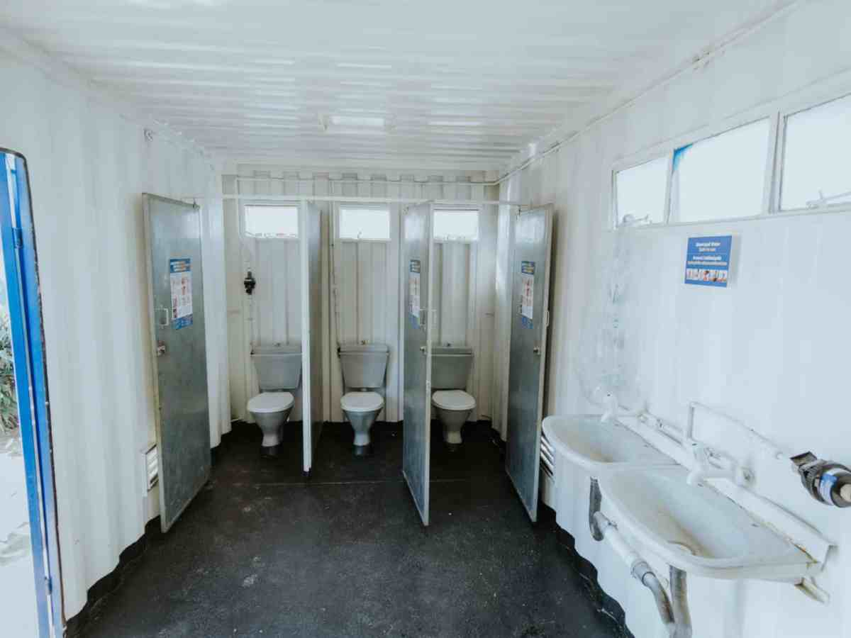 A shipping container used as a communal toilet outside Durban, South Africa, holds a new toilet prototype designed by researchers at Duke University
