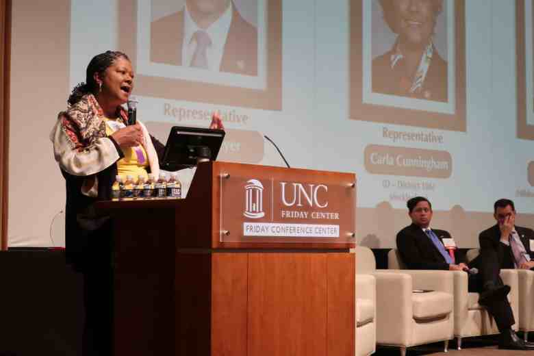 Shows an African American woman at a podium telling a moving story about her son with severe, persistent mental illness