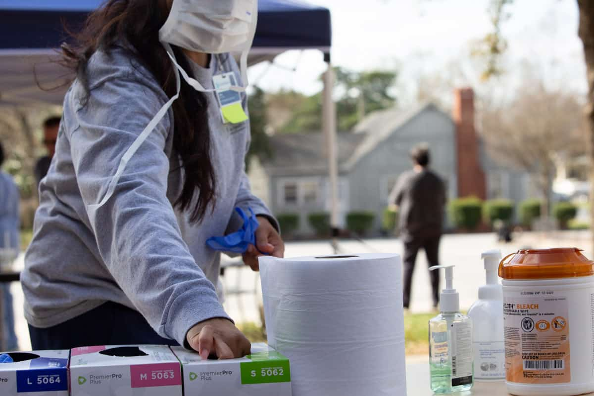 Cone Health drive-thru clinic personnel get supplies outside.