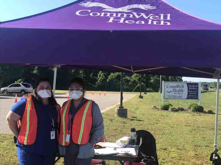 Workers at CommWell Health, directly almost directly across from Smithfield Food's hog processing plant, check people in at a drive-thru testing site for people who suspect they may have the coronavirus. More than 350 tests have been made. Photo credit: Greg Barnes