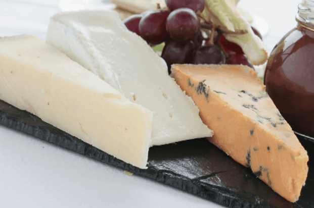 shows three types of cheese on a tray