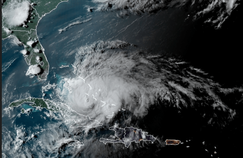 shows a hurricane moving across the Atlantic near Cuba in a satellite image