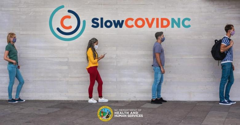 """image shows a line of four people waiting for something while following social distancing procedures. the top says """"SlowCOVIDNC"""" and the bottom has the NC Department of Health and Human Services logo"""