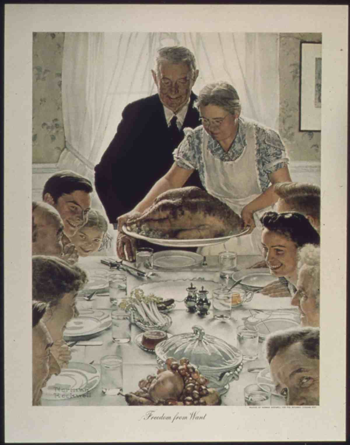 A large family gathered at a table for a holiday meal as the turkey arrives at the table in this classic painting