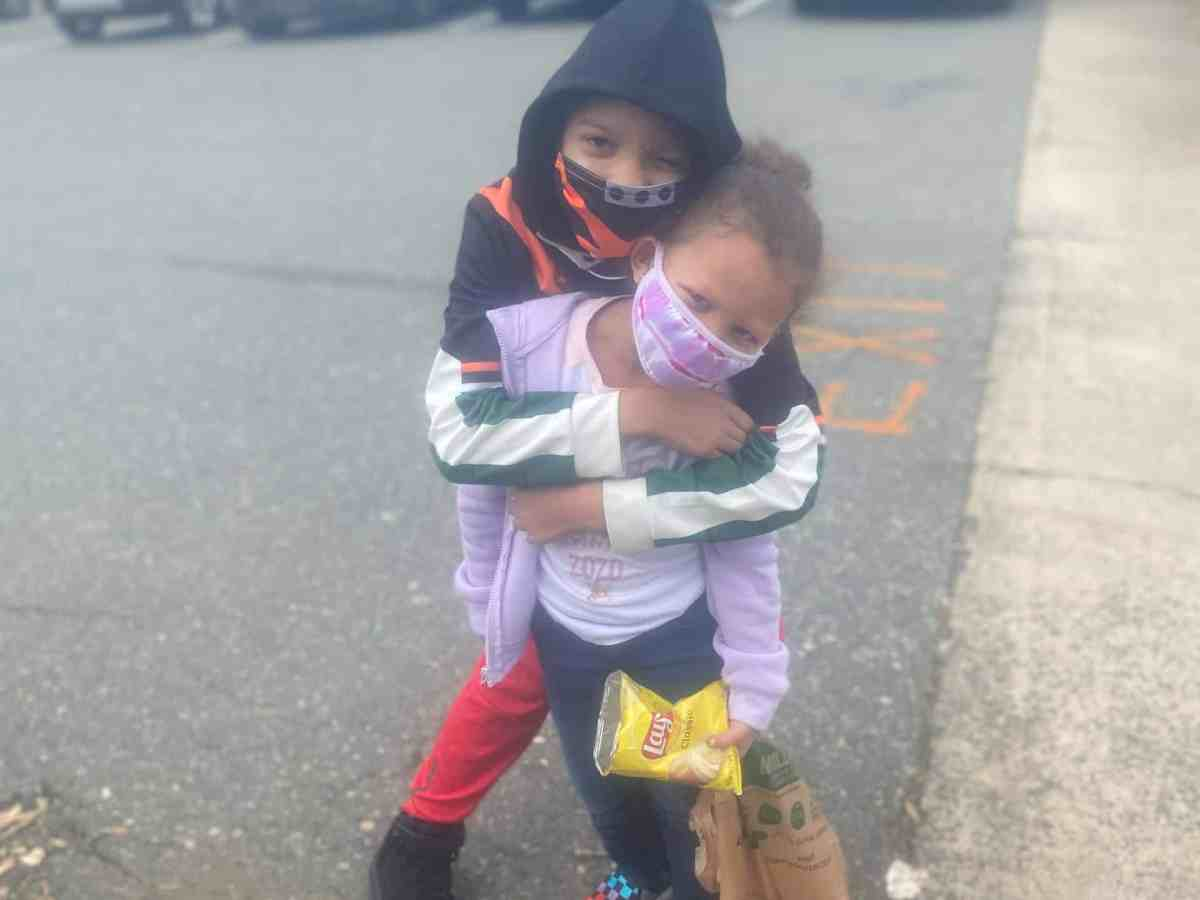 We see Jayla, age 11, hugging her sister Bailey, age 5, before they were pepper sprayed at a voting rights rally on Oct. 31 in Graham, North Carolina.