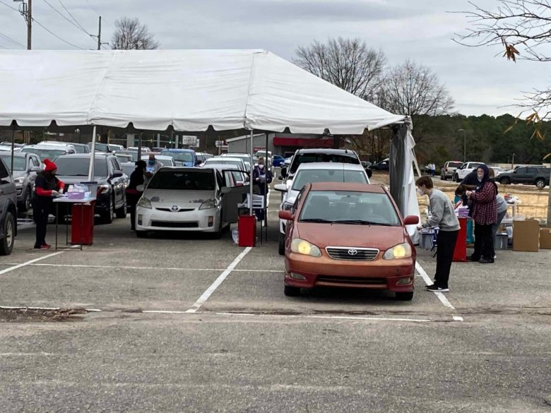 People line up in six lanes to await COVID-19 testing at a site in Fayetteville. Photo credit: Greg Barnes