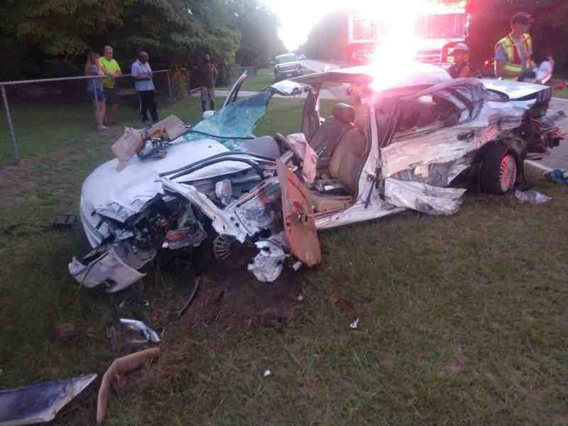shows a hulk of a vehicle that was infolved in a wreck and a fire