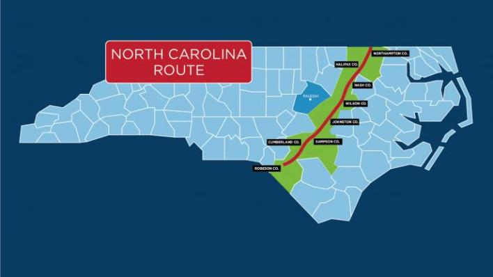 Shows a map of north carolina with a red line marking the route of the pipeline and the counties/ communities it passes through designated in green. The Counties are Northampton, Halifax, Nash, Wilson, Johnston, Sampson, Cumberland and Robeson.