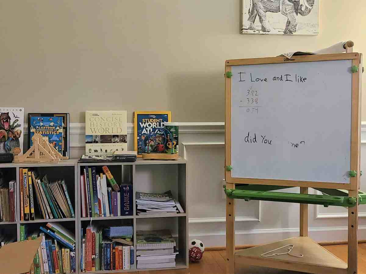 A corner of homeschooling setup in a North Carolina family with bookshelf and whiteboard.