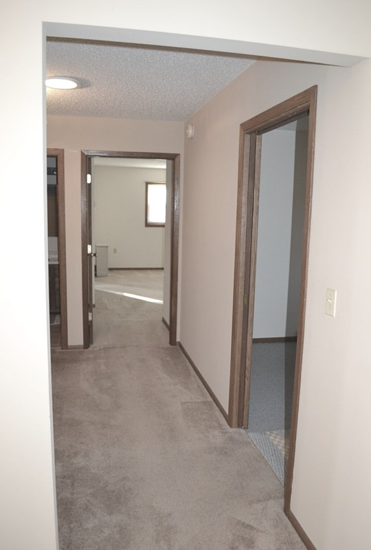 The bedroom hallway, with the master bedroom straight, office to the right and bathroom to the left.