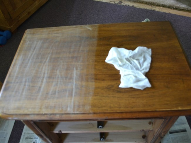 cleaning a sanded night stand to prepare for painting