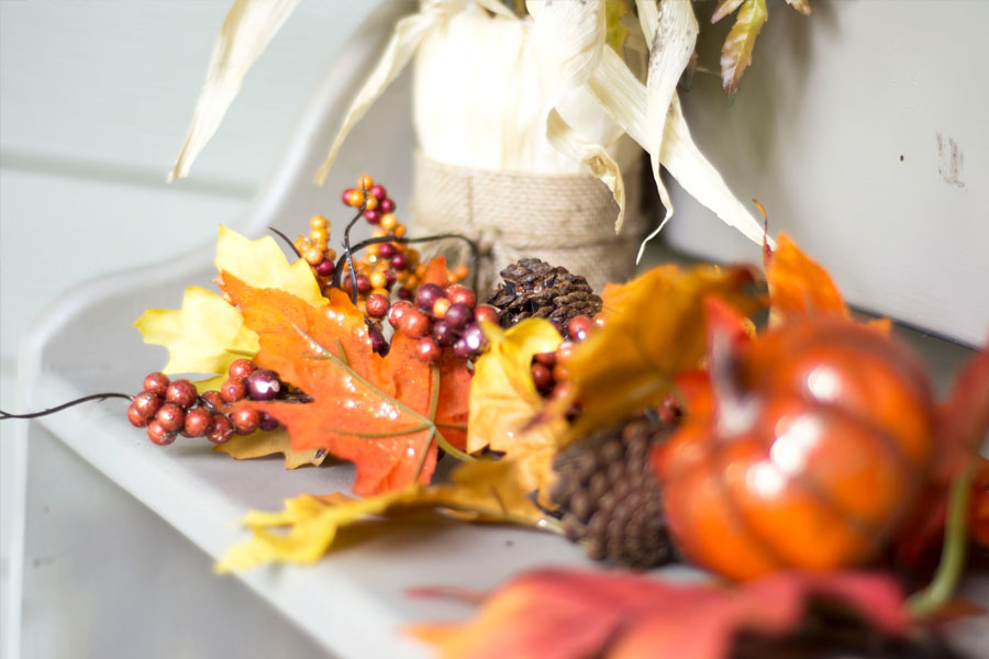 fall porch decor on shelves