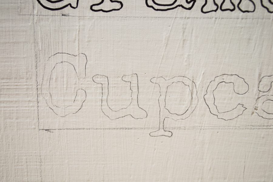 traced words on plywood sign with carbon paper to make DIY farmhouse sign