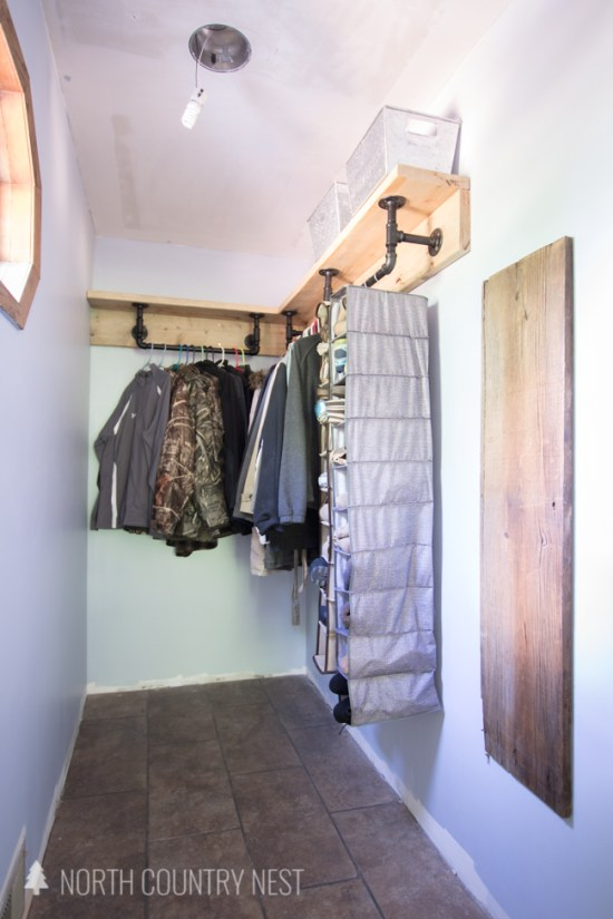 closet storage and organization with industrial pipe shelving system
