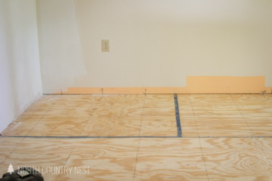 marking stud lines to install plywood flooring
