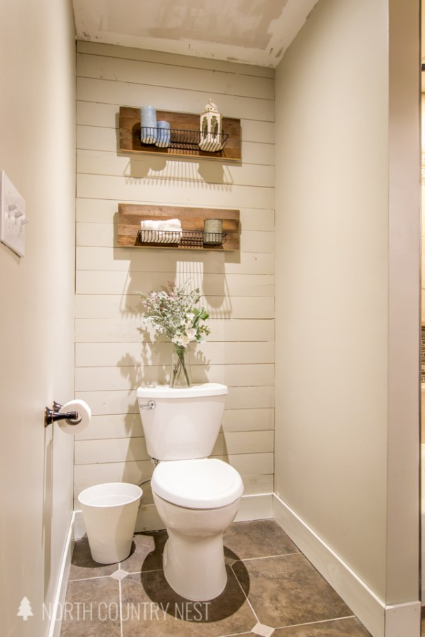 shiplap wall in bathroom with industrial shelving