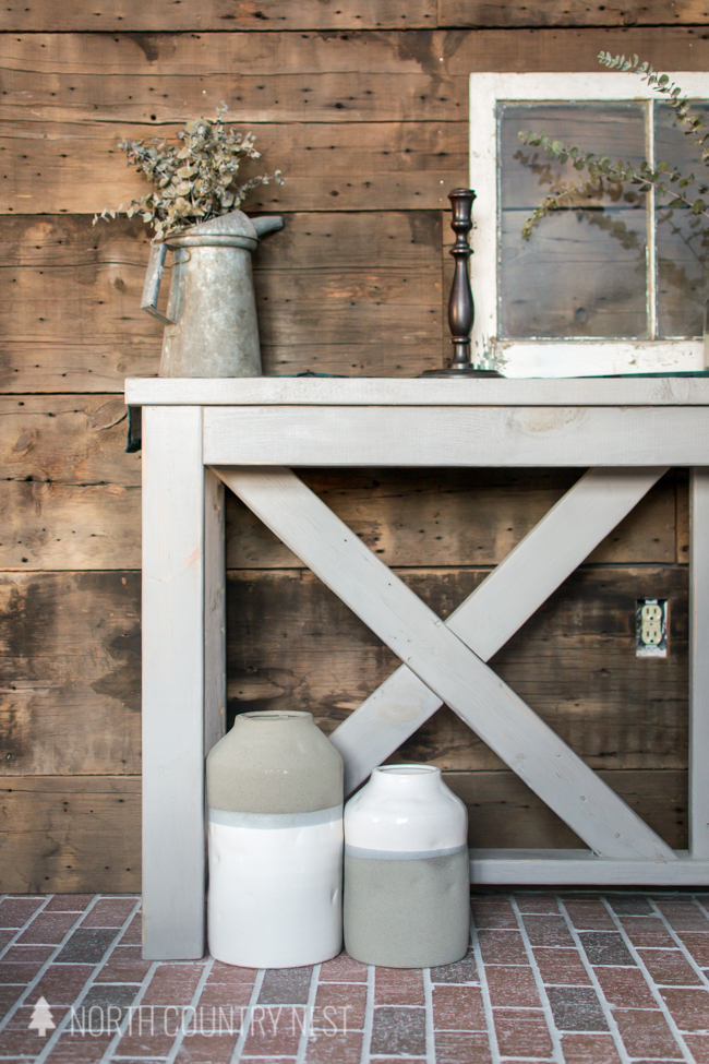 entryway table with vases and eucalyptus