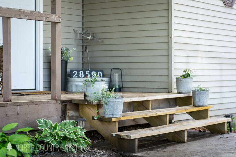 simple porch decor with galvanized buckets