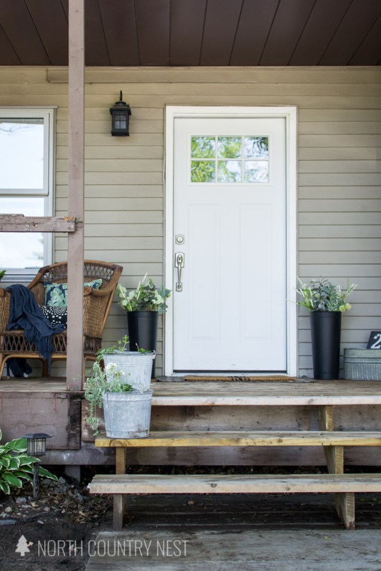 simple front porch decor with galvanized buckets for plants