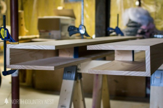 floating wood shelves held together by clamps